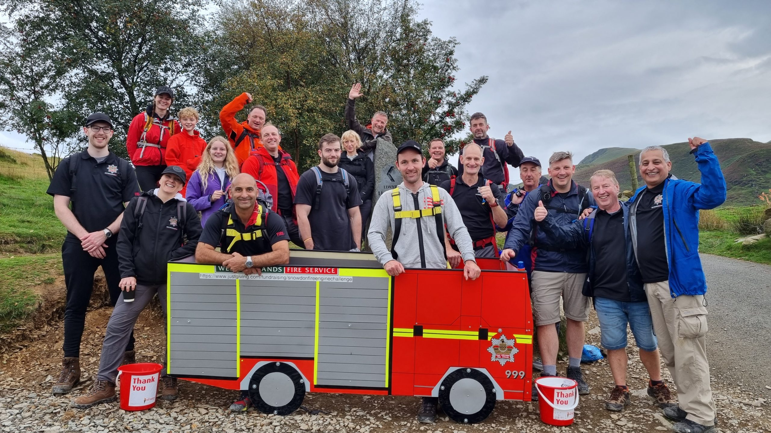 Team carry mini fire engine up mountain in aid of Charity