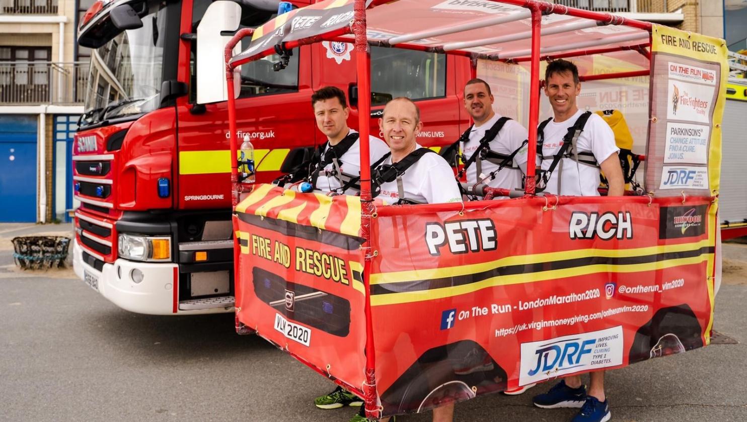 Firefighters running London Marathon in mini fire engine